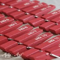 24 rote Holzklammern für Adventskalender